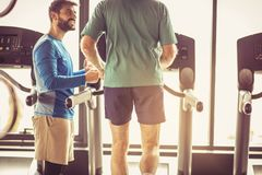 Support. Senior man at gym. Royalty Free Stock Images