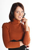 Support service on communication. The young and beautiful girl from a support service in a red jacket Royalty Free Stock Photography