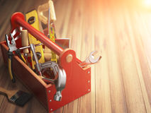 Support service concept. Toolbox with tools on wooden background Royalty Free Stock Photo