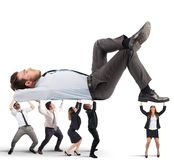 Support of  team effort. Men and women support a big man Stock Photos
