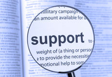 Support. Thru a magnifying glass Royalty Free Stock Photos
