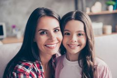 Support, trust stable, strong family concept. Close up portrait. Of happy tender smiling mom and her lovely cute preteen child, they are hugging Stock Image