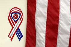 Support volunteer firefighters. With flag Stock Image