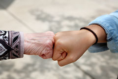Support. Young hands supporting old hands-helping elderly people concept-black and white image with selective focus royalty free stock photo