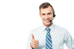 We support your business !. Customer support executive showing thumbs up Stock Images