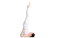 Supported Shoulderstand yoga asana stock photography