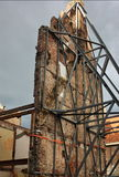 Supported wall on old building. Iron or metals girders supporting tall wall of old urban building Stock Photography