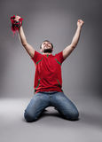 Supporter. Happy supporter with his hands up posing Royalty Free Stock Photos