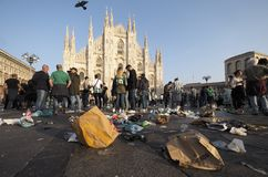 MILAN, Italy: 25 October 2018: Wastes in Duomo square, Milan, Lombardy. Supporter Betis Siviglia dirty Duomo square of waste before Europa league match against royalty free stock photos