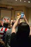 Supporter Uses Cellphone to take photo of Former President Bill Stock Photo