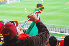 Supporter with vuvusela. Portugal supporter on the stands during World Cup Stock Image