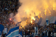 Supporters burn flares Stock Image