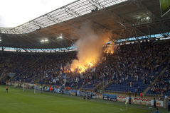 Supporters burn flares Stock Photos