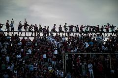 Supporters. A crowd of supporters hanging in the stands in a soccer match Stock Image