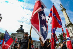 Supporters of the Confederate Flag. Supporters of flying the Confederate Flag gather at the South Carolina State House near the Confederate Soldier monument royalty free stock photos