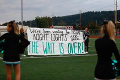 Supporter banner at high school football game. Supporters holding a banner at a high school football game royalty free stock photos