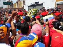 Supporters of Hugo Chavez. CARACAS, VENEZUELA-MAR. 06: Supporters of Hugo Chavez crowd the area nearby the Military Hospital as Chavezs casket is driven through Stock Image