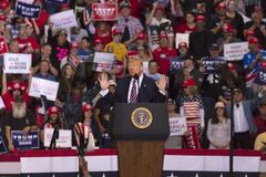 Supporters under US Flag at President Trump Re-election Rally - KEEP AMERICA GREAT