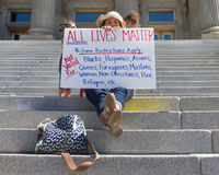 Supporting Black Lives matter at the Capital. BOISE, IDAHO-JULY 16 2016: Woman holds an All lives matter showing the irony of the statement Royalty Free Stock Photography