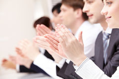 Supporting idea. Photo of business partners hands applauding at meeting with lovely female at foreground Stock Images