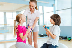 Supporting kids in training. Stock Photo