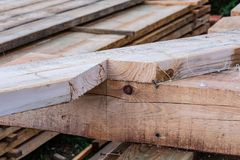 Details of the construction of a frame house. Supporting lock of a wooden beam for connection to the floor of the house. Supporting lock of a wooden beam for stock image