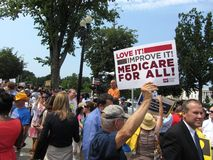Supporting Obamacare. Photo of man who supports obamacare at the supreme court in washington dc on 6/28/12.  The supreme court upheld president obama's health Royalty Free Stock Photo