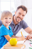 Supporting son in his studying. Royalty Free Stock Photography