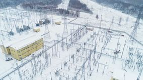 Supporting tower sets electrical equipment in cold weather. Drone view supporting towers set electrical equipment and constructions at substation in cold weather stock video