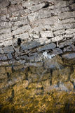Supporting wall. Supporting stone wall and water as a background royalty free stock photography