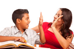 Supportive Hispanic Mother and Son Studying Stock Image