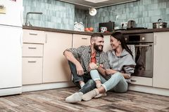 Supportive loving bearded husband hugging his beautiful woman. Supportive husband. Supportive loving bearded husband hugging his beautiful stylish woman stock images