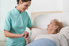 Supportive nurse with old lady Royalty Free Stock Photography