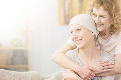 Supportive older woman. Supportive older women hugging her friend struggling with cancer Royalty Free Stock Image