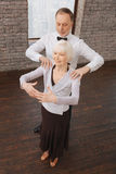 Supportive retired couple performing in the dance studio Stock Photography