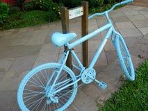 Supporto della bicicletta sulla via Immagini Stock