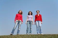 Supporto delle ragazze sul prato Immagine Stock