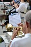 Supporto di musica con le note e la tromba Immagini Stock