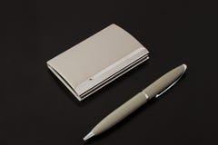 Supporto di scheda con la penna fotografie stock