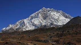 Supporto Nuptse, alta montagna dell'Himalaya Immagine Stock
