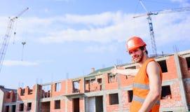 Supporto protettivo del casco del tipo davanti a costruzione fatta dai mattoni Controlli il processo della costruzione Maglia del immagini stock