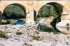 Supports of ancient Roman aqueduct Pont du Gard. Travel to Provence, France - supports of ancient Roman aqueduct Pont du Gard in Gardon River near Vers-Pont-du Royalty Free Stock Photos