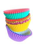 Supports colorés de petit gâteau Photographie stock