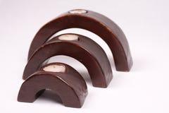 Supports de bougie en bois arqués Image stock