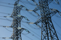Supports of e electric mains. Support of electric mains against the blue sky Stock Photo