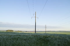 Supports high-voltage line at dawn in the hills Stock Photography