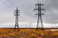 Supports high-voltage line. The tundra in the Arctic Circle Royalty Free Stock Photos