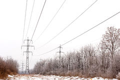 Supports high-voltage power lines winter Stock Images