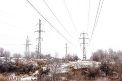 Supports high-voltage power lines winter Stock Photos