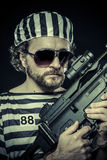 Suppresion, Prison riot concept. Man holding a machine gun, pris Royalty Free Stock Photos